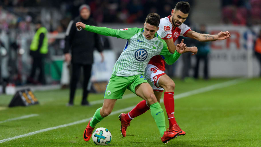 MAINZ, GERMANY - FEBRUARY 23: Josip Brekalo of Wolfsburg in action against Gerrit Holtmann of Mainz during the Bundesliga match between 1. FSV Mainz 05 and VfL Wolfsburg at Opel Arena on February 23, 2018 in Mainz, Germany. (Photo by Alexander Scheuber/Bongarts/Getty Images)