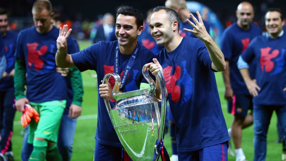 BERLIN, GERMANY - JUNE 06: Xavi Hernandez (L) and Andres Iniesta of Barcelona celebrate with the trophy after the UEFA Champions League Final between Juventus and FC Barcelona at Olympiastadion on June 6, 2015 in Berlin, Germany.  (Photo by Paul Gilham/Getty Images)