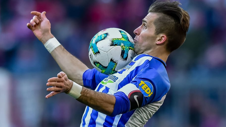 TOPSHOT - Berlin's Slovakian defender Peter Pekarik plays the ball during the German first division Bundesliga football match Bayern Munich vs Hertha Berlin in Munich, southern Germany, on February 24, 2018. / AFP PHOTO / Guenter SCHIFFMANN / RESTRICTIONS: DURING MATCH TIME: DFL RULES TO LIMIT THE ONLINE USAGE TO 15 PICTURES PER MATCH AND FORBID IMAGE SEQUENCES TO SIMULATE VIDEO. == RESTRICTED TO EDITORIAL USE == FOR FURTHER QUERIES PLEASE CONTACT DFL DIRECTLY AT + 49 69 650050         (Photo credit should read GUENTER SCHIFFMANN/AFP/Getty Images)