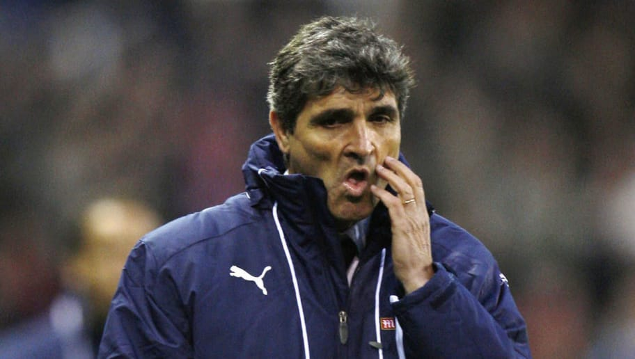 Tottenham Hotspur's Coach Juande Ramos walks off the pitch following the game against Stoke City during the Premiership match at The Britannia Stadium in Stoke on October 19, 2008. Stoke won the game 2-1 with Tottenham having two players sent off in the match. AFP PHOTO / Adrian Dennis  Mobile and website use of domestic English football pictures are subject to obtaining a Photographic End User Licence from Football DataCo Ltd Tel : +44 (0) 207 864 9121 or e-mail accreditations@football-dataco.com - applies to Premier and Football League matches. (Photo credit should read ADRIAN DENNIS/AFP/Getty Images)