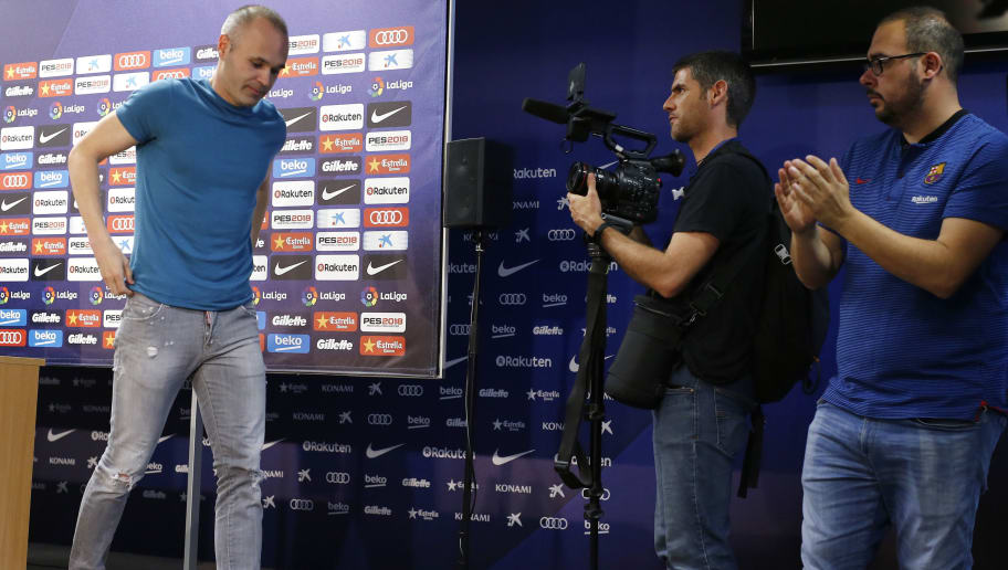 Barcelona's Spanish midfielder Andres Iniesta (L) leaves after giving a press conference at the Joan Gamper Sports Center in Sant Joan Despi, near Barcelona, on April 27, 2018. - Iniesta confirmed that he will leave Barcelona at the end of the season. (Photo by Pau Barrena / AFP)        (Photo credit should read PAU BARRENA/AFP/Getty Images)