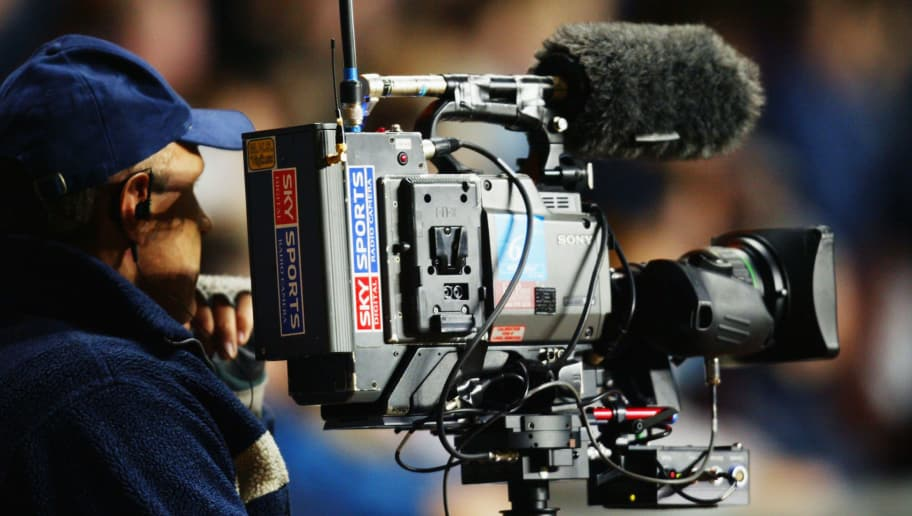 BIRMINGHAM - JANUARY 6:  Sky Sports TV cameraman filming during the FA Barclaycard Premiership match between Aston Villa and Portsmouth on January 6, 2004 at Villa Park in Birmingham, England.  Aston Villa won the match 2-1.  (Photo by Ross Kinnaird/Getty Images)