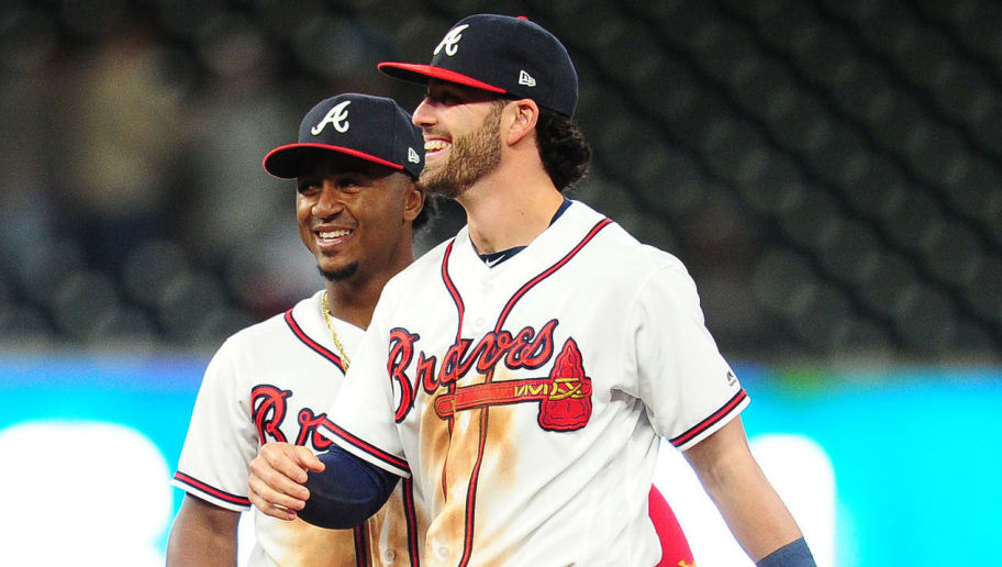 ATLANTA, GA - APRIL 19: Dansby Swanson #7 and Ozzie Albies #1 of the Atlanta Braves celebrate after the game against the New York Mets at SunTrust Park on April 19, 2018 in Atlanta, Georgia. (Photo by Scott Cunningham/Getty Images)