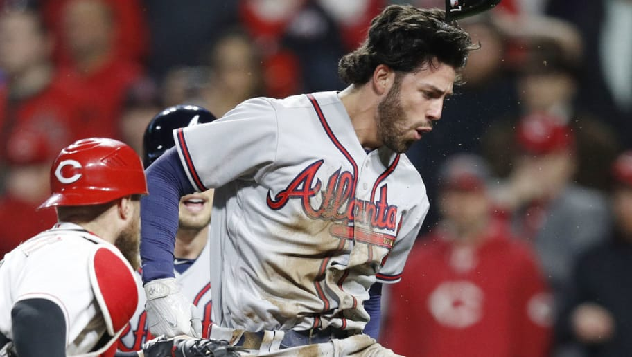 CINCINNATI, OH - APRIL 24: Dansby Swanson #7 of the Atlanta Braves reacts after scoring the game-tying run on an infield single by Ender Inciarte in the ninth inning of a game against the Cincinnati Reds at Great American Ball Park on April 24, 2018 in Cincinnati, Ohio. The Reds won 9-7 in 12 innings. (Photo by Joe Robbins/Getty Images)