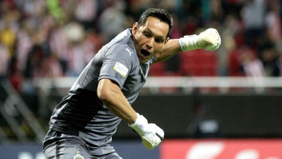 Rodolfo Cota of Mexico´s Guadalajara goalkeeper celebrates the goal of his teammate Isaac Brizuela (out of frame) against the New York Red Bulls during the first leg CONCACAF Champions League semifinals match at Akron stadium in Guadalajara, Jalisco State, Mexico on April 4, 2018. / AFP PHOTO / ULISES RUIZ        (Photo credit should read ULISES RUIZ/AFP/Getty Images)