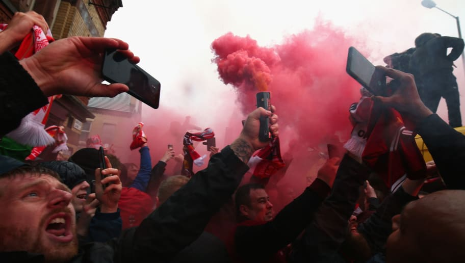 LIVERPOOL, ENGLAND - APRIL 24:  Liverpool fans light flares outside the stadium prior to the UEFA Champions League Semi Final First Leg match between Liverpool and A.S. Roma at Anfield on April 24, 2018 in Liverpool, United Kingdom.  (Photo by Clive Brunskill/Getty Images)