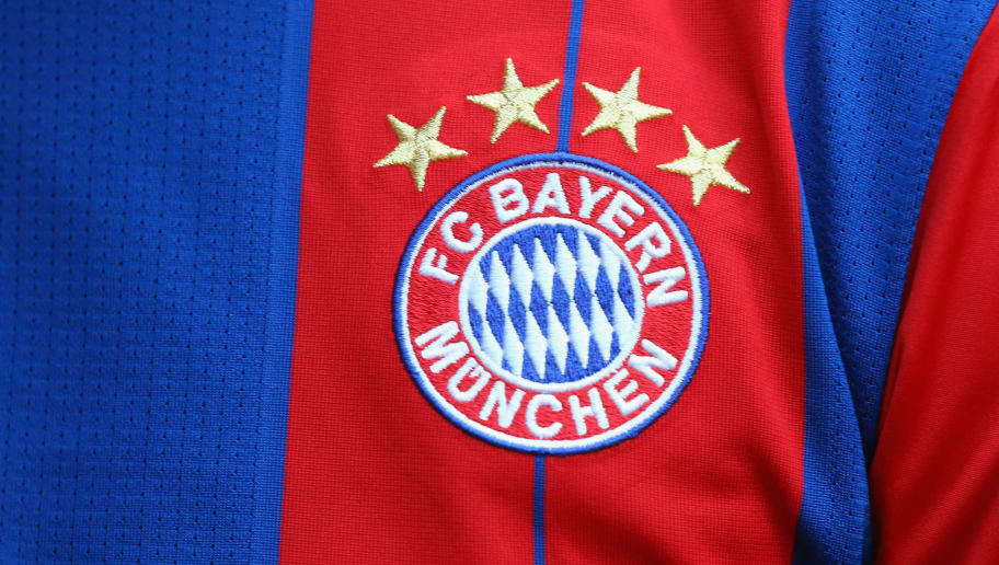 MUNICH, GERMANY - AUGUST 22:  The FC Bayern Munich logo is dispatch on the match jersey during the Bundesliga match between FC Bayern Muenchen and VfL Wolfsburg at Allianz Arena on August 22, 2014 in Munich, Germany.  (Photo by Alexander Hassenstein/Bongarts/Getty Images)