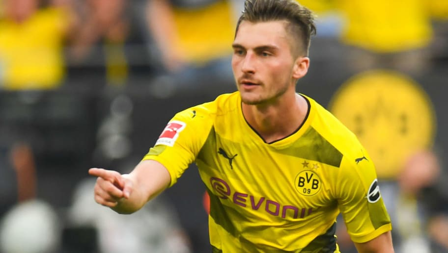 Dortmund's German forward Maximilian Philipp celebrates after scoring during the German first division Bundesliga football match Borussia Dortmund vs Bayer Leverkusen, in Dortmund, western Germany, on April 21, 2018. (Photo by Patrik STOLLARZ / AFP) / RESTRICTIONS: DURING MATCH TIME: DFL RULES TO LIMIT THE ONLINE USAGE TO 15 PICTURES PER MATCH AND FORBID IMAGE SEQUENCES TO SIMULATE VIDEO. == RESTRICTED TO EDITORIAL USE == FOR FURTHER QUERIES PLEASE CONTACT DFL DIRECTLY AT + 49 69 650050        (Photo credit should read PATRIK STOLLARZ/AFP/Getty Images)