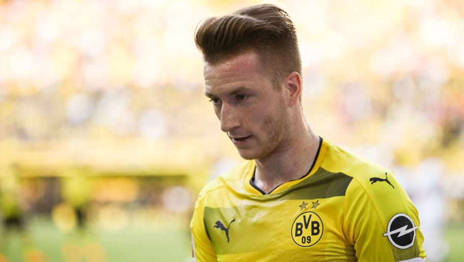 DORTMUND, GERMANY - APRIL 21: Marco Reus #11 of Borussia Dortmund reacts during the Bundesliga match between Borussia Dortmund and Bayer 04 Leverkusen at Signal Iduna Park on April 21, 2018 in Dortmund, Germany. (Photo by Maja Hitij/Bongarts/Getty Images)