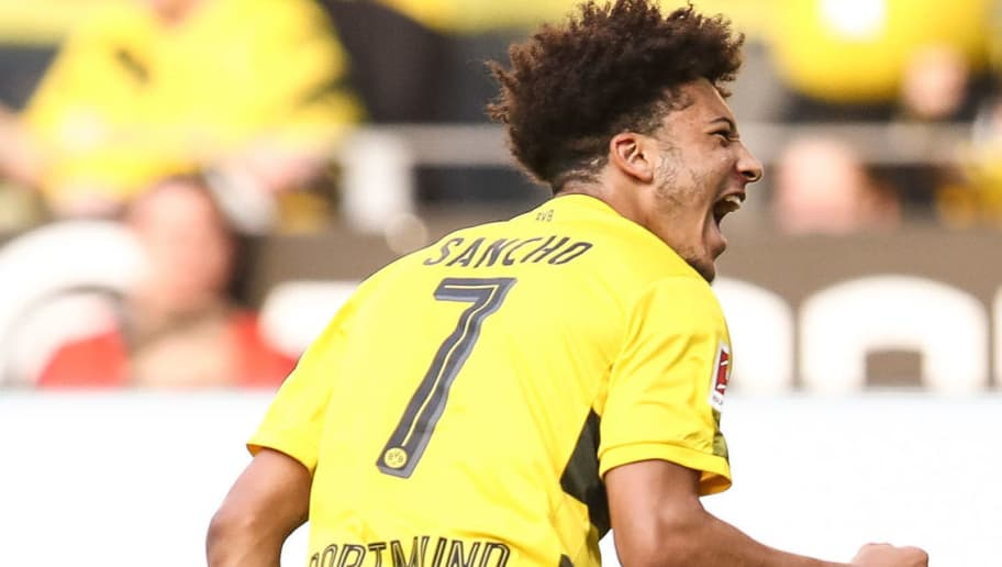 DORTMUND, GERMANY - APRIL 21: Jadon Sancho #7 of Borussia Dortmund celebrates after scoring a goal to make it 1-0 during the Bundesliga match between Borussia Dortmund and Bayer 04 Leverkusen at Signal Iduna Park on April 21, 2018 in Dortmund, Germany. (Photo by Maja Hitij/Bongarts/Getty Images)