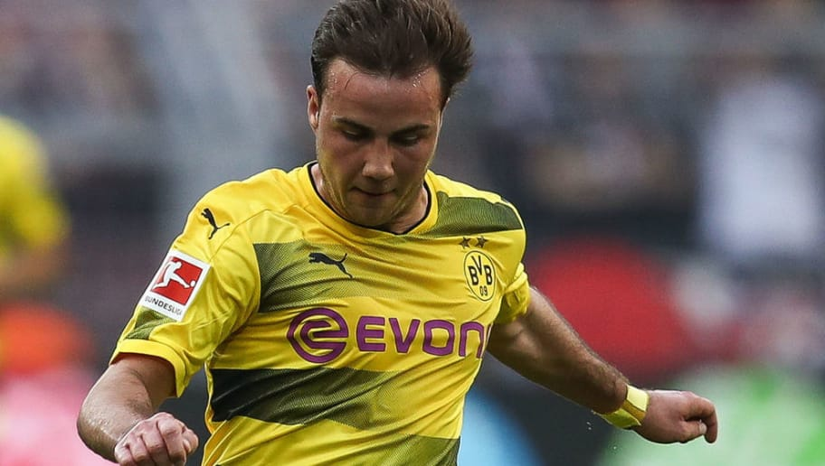 DORTMUND, GERMANY - APRIL 21: Mario Gotze #10 of Borussia Dortmund controls the ball during the Bundesliga match between Borussia Dortmund and Bayer 04 Leverkusen at Signal Iduna Park on April 21, 2018 in Dortmund, Germany. (Photo by Maja Hitij/Bongarts/Getty Images)