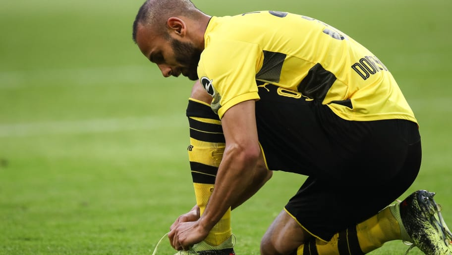 DORTMUND, GERMANY - APRIL 21: Omer Toprak #36 of Borussia Dortmund tightens his shoe during the Bundesliga match between Borussia Dortmund and Bayer 04 Leverkusen at Signal Iduna Park on April 21, 2018 in Dortmund, Germany. (Photo by Maja Hitij/Bongarts/Getty Images)