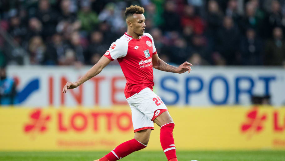 MAINZ, GERMANY - APRIL 01: Jean-Philippe Gbamin of Mainz controls the ball during the Bundesliga match between 1. FSV Mainz 05 and Borussia Moenchengladbach at Opel Arena on April 1, 2018 in Mainz, Germany. (Photo by Simon Hofmann/Bongarts/Getty Images)