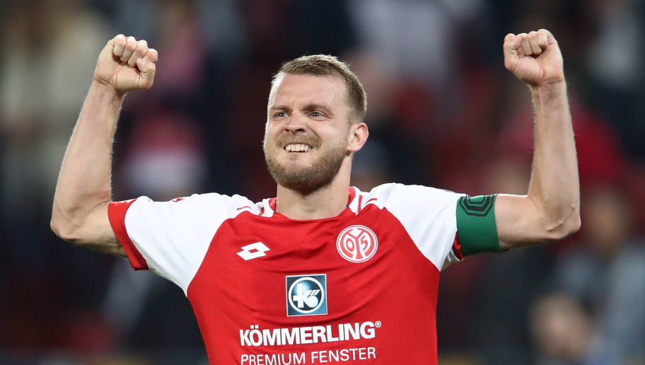 MAINZ, GERMANY - APRIL 16: Daniel Brosinski  of Mainz celebrates after the Bundesliga match between 1. FSV Mainz 05 and Sport-Club Freiburg at Opel Arena on April 16, 2018 in Mainz, Germany.  (Photo by Alex Grimm/Bongarts/Getty Images)