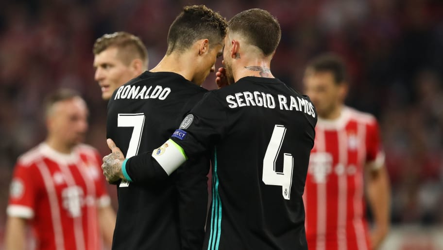 MUNICH, GERMANY - APRIL 25: Cristiano Ronaldo #7 of Real Madrid and Sergio Ramos #4 of Real Madrid talk during the UEFA Champions League Semi Final First Leg match between Bayern Muenchen and Real Madrid at the Allianz Arena on April 25, 2018 in Munich, Germany. (Photo by Maja Hitij/Bongarts/Getty Images)