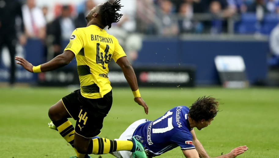 GELSENKIRCHEN, GERMANY - APRIL 15: Benjamin Stambouli of Schalke (R) foulsMichy Batshuayi of Dortmund (L) who got an injury during the Bundesliga match between FC Schalke 04 and Borussia Dortmund at Veltins-Arena on April 15, 2018 in Gelsenkirchen, Germany. The match between Schalke and Dortmund ended 2-0 (Photo by Christof Koepsel/Bongarts/Getty Images)