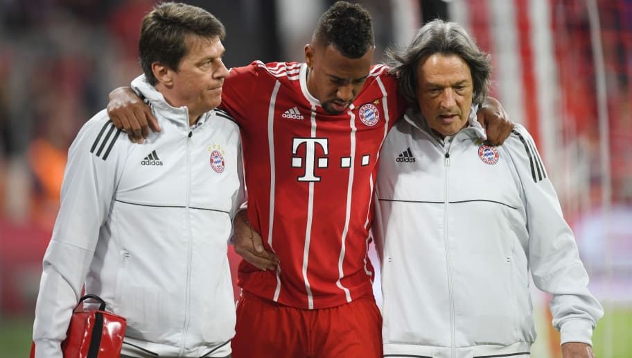 Bayern Munich's German defender Jerome Boateng (C) walks off the pitch with the help of team doctor Hans-Wilhelm Mueller-Wohlfahrt (R)after getting injured during the UEFA Champions League semi-final first-leg football match FC Bayern Munich v Real Madrid CF in Munich in southern Germany on April 25, 2018. (Photo by Christof STACHE / AFP)        (Photo credit should read CHRISTOF STACHE/AFP/Getty Images)