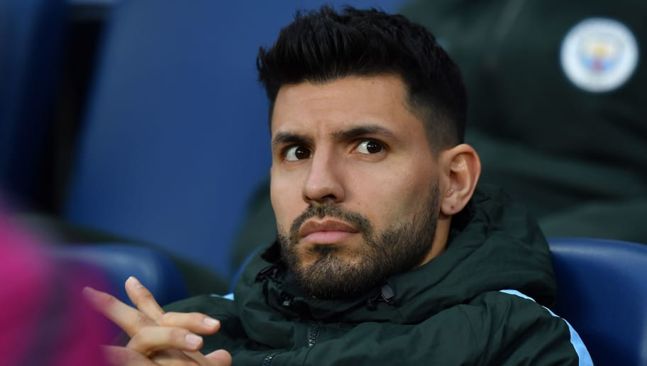 Manchester City's Argentinian striker Sergio Aguero sits on the bench ahead of the UEFA Champions League second leg quarter-final football match between Manchester City and Liverpool, at the Etihad Stadium in Manchester, north west England on April 10, 2018. / AFP PHOTO / Anthony Devlin        (Photo credit should read ANTHONY DEVLIN/AFP/Getty Images)