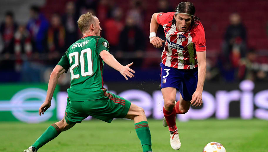 Lokomotiv Moscow's Russian midfielder Vladislav Ignatyev (L) vies with Atletico Madrid's Brazilian defender Filipe Luis during the Europa League Round of 16 first leg football match between Club Atletico de Madrid and FC Lokomotiv Moscow at the Wanda Metropolitano stadium in Madrid on March 8, 2018. / AFP PHOTO / JAVIER SORIANO        (Photo credit should read JAVIER SORIANO/AFP/Getty Images)
