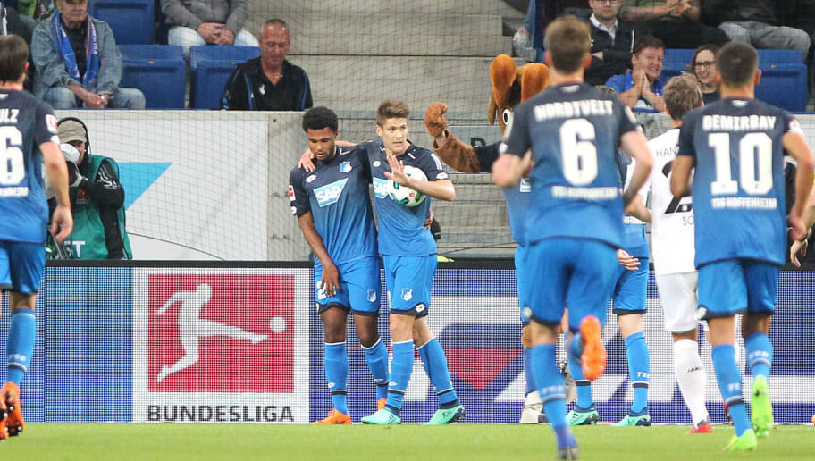 Hoffenheim's Croatian forward Andrej Kramaric (C-R) is congratulated by Hoffenheims's German midfielder Serge Gnabry (C-L) and other teammates after scoring a goal during the German First division Bundesliga football match TSG 1899 Hoffenheim vs Hanover 96 in Sinsheim, southern Germany on April 27, 2018. (Photo by Daniel ROLAND / AFP) / RESTRICTIONS: DURING MATCH TIME: DFL RULES TO LIMIT THE ONLINE USAGE TO 15 PICTURES PER MATCH AND FORBID IMAGE SEQUENCES TO SIMULATE VIDEO. == RESTRICTED TO EDITORIAL USE == FOR FURTHER QUERIES PLEASE CONTACT DFL DIRECTLY AT + 49 69 650050 / RESTRICTIONS: DURING MATCH TIME: DFL RULES TO LIMIT THE ONLINE USAGE TO 15 PICTURES PER MATCH AND FORBID IMAGE SEQUENCES TO SIMULATE VIDEO. == RESTRICTED TO EDITORIAL USE == FOR FURTHER QUERIES PLEASE CONTACT DFL DIRECTLY AT + 49 69 650050        (Photo credit should read DANIEL ROLAND/AFP/Getty Images)