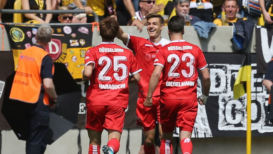 DRESDEN, GERMANY - APRIL 28:  Florian Neuhaus (C) of Duesseldorf jubilates with team mates after scoring the first goal during the Second Bundesliga match between SG Dynamo Dresden and Fortuna Duesseldorf at DDV-Stadion on April 28, 2018 in Dresden, Germany.  (Photo by Matthias Kern/Bongarts/Getty Images)