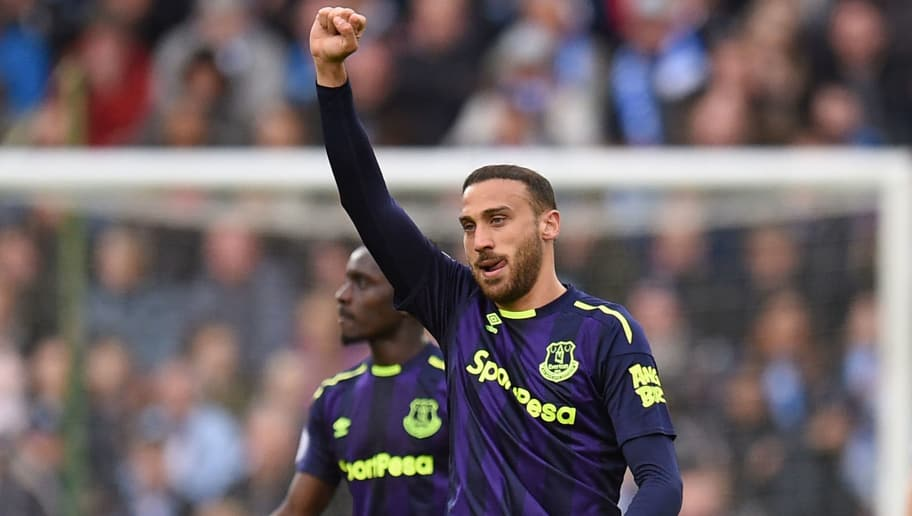 Everton's Turkish striker Cenk Tosun celebrates after scoring the opening goal of the English Premier League football match between Huddersfield Town and Everton at the John Smith's stadium in Huddersfield, northern England on April 28, 2018. (Photo by Oli SCARFF / AFP) / RESTRICTED TO EDITORIAL USE. No use with unauthorized audio, video, data, fixture lists, club/league logos or 'live' services. Online in-match use limited to 75 images, no video emulation. No use in betting, games or single club/league/player publications. /         (Photo credit should read OLI SCARFF/AFP/Getty Images)