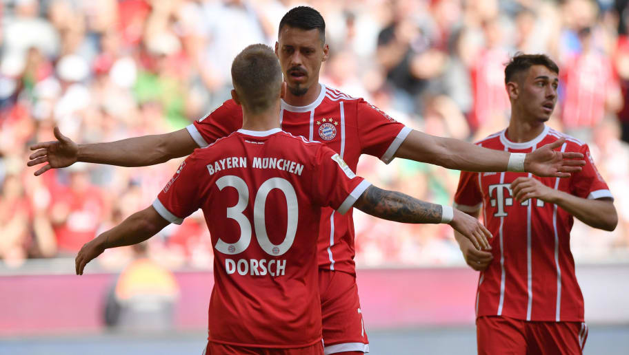 MUNICH, GERMANY - APRIL 28: Niklas Dorsch of Bayern Muenchen celebrates with teammate Sandro Wagner scoring his teams first goal during the Bundesliga match between FC Bayern Muenchen and Eintracht Frankfurt at Allianz Arena on April 28, 2018 in Munich, Germany. (Photo by Sebastian Widmann/Bongarts/Getty Images)