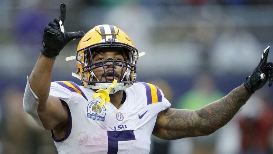 3ORLANDO, FL - JANUARY 01: Derrius Guice #5 of the LSU Tigers reacts after a two-yard reception for touchdown against the Notre Dame Fighting Irish in the fourth quarter of the Citrus Bowl on January 1, 2018 in Orlando, Florida. Notre Dame won 21-17. (Photo by Joe Robbins/Getty Images)