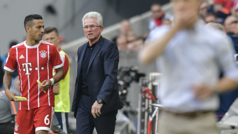 Bayern Munich's German head coach Jupp Heynckes (2nd L) stands next to Bayern Munich's Spanish midfielder Thiago Alcantara (L) during the German first division Bundesliga football match FC Bayern Munich vs Eintracht Frankfurt in Munich, southern Germany on April 28, 2018. (Photo by Guenter SCHIFFMANN / AFP) / RESTRICTIONS: DURING MATCH TIME: DFL RULES TO LIMIT THE ONLINE USAGE TO 15 PICTURES PER MATCH AND FORBID IMAGE SEQUENCES TO SIMULATE VIDEO. == RESTRICTED TO EDITORIAL USE == FOR FURTHER QUERIES PLEASE CONTACT DFL DIRECTLY AT + 49 69 650050        (Photo credit should read GUENTER SCHIFFMANN/AFP/Getty Images)