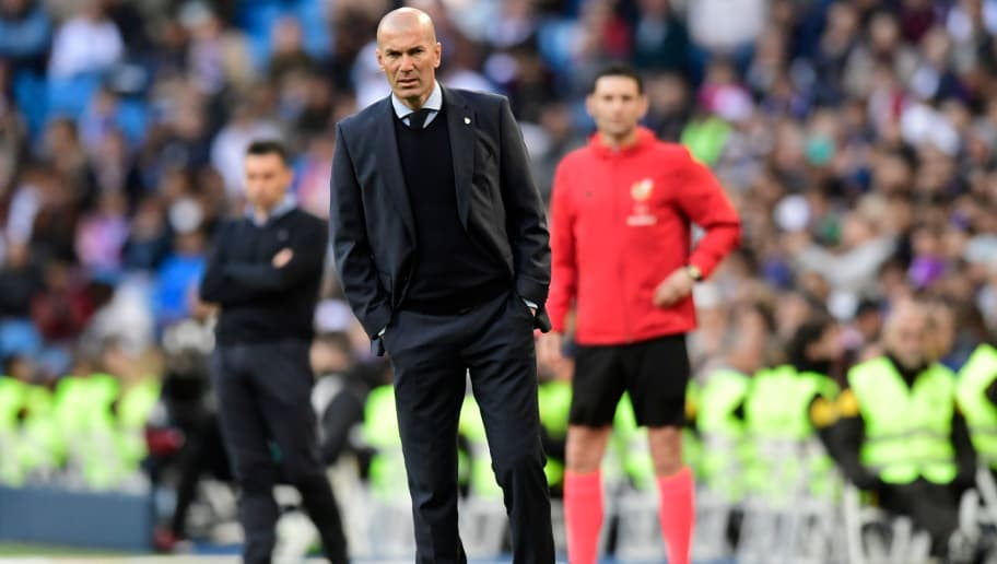 Real Madrid's French coach Zinedine Zidane reacts during the Spanish League football match between Real Madrid and Leganes at the Santiago Bernabeu Stadium in Madrid on April 28, 2018. (Photo by JAVIER SORIANO / AFP)        (Photo credit should read JAVIER SORIANO/AFP/Getty Images)