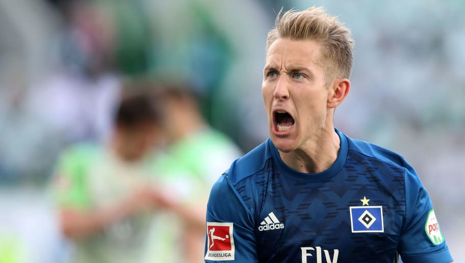 Hamburg's German midfielder Lewis Holtby reacts during the German first division Bundesliga football match VfL Wolfsburg vs Hamburger SV in Wolfsburg, northern Germany, on April 28, 2018. (Photo by Ronny Hartmann / AFP) / RESTRICTIONS: DURING MATCH TIME: DFL RULES TO LIMIT THE ONLINE USAGE TO 15 PICTURES PER MATCH AND FORBID IMAGE SEQUENCES TO SIMULATE VIDEO. == RESTRICTED TO EDITORIAL USE == FOR FURTHER QUERIES PLEASE CONTACT DFL DIRECTLY AT + 49 69 650050        (Photo credit should read RONNY HARTMANN/AFP/Getty Images)