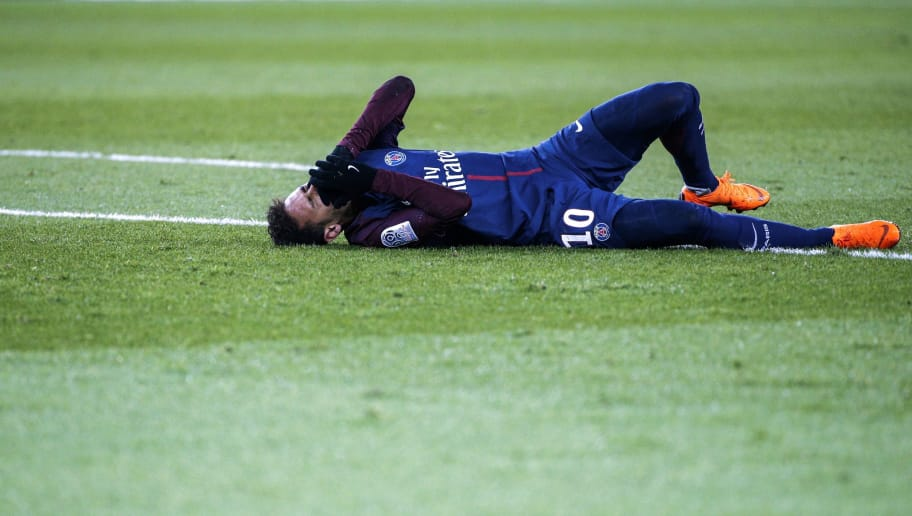 Paris Saint-Germain's Brazilian forward Neymar Jr reacts lying on the pitch during the French L1 football match between Paris Saint-Germain (PSG) and Marseille (OM) at the Parc des Princes in Paris on February 25, 2018.  / AFP PHOTO / GEOFFROY VAN DER HASSELT        (Photo credit should read GEOFFROY VAN DER HASSELT/AFP/Getty Images)