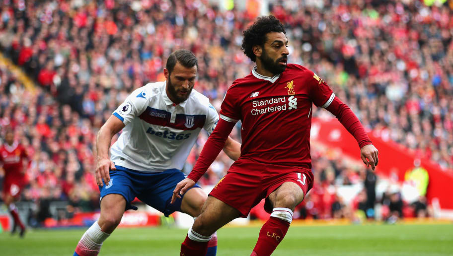 LIVERPOOL, ENGLAND - APRIL 28:  Mohamed Salah of Liverpool and Kevin Wimmer of Stoke City in action during the Premier League match between Liverpool and Stoke City at Anfield on April 28, 2018 in Liverpool, England.  (Photo by Clive Brunskill/Getty Images)