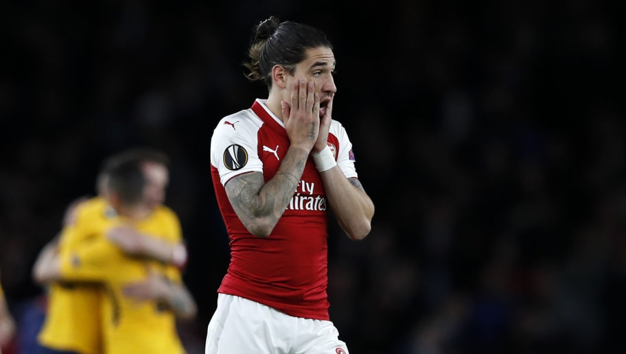 Arsenal's Spanish defender Hector Bellerin (R) reacts on the pitch after the UEFA Europa League first leg semi-final football match  between Arsenal and Atletico Madrid at the Emirates Stadium in London on April 26, 2018. - The game finished 1-1. (Photo by Adrian DENNIS / AFP)        (Photo credit should read ADRIAN DENNIS/AFP/Getty Images)