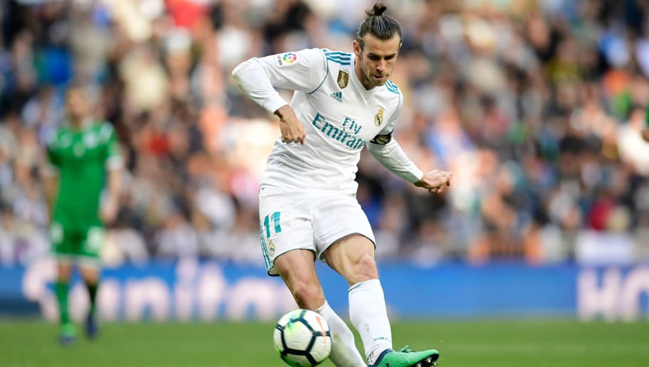 Real Madrid's Welsh forward Gareth Bale kicks the ball during the Spanish League football match between Real Madrid and Leganes at the Santiago Bernabeu Stadium in Madrid on April 28, 2018. (Photo by JAVIER SORIANO / AFP)        (Photo credit should read JAVIER SORIANO/AFP/Getty Images)