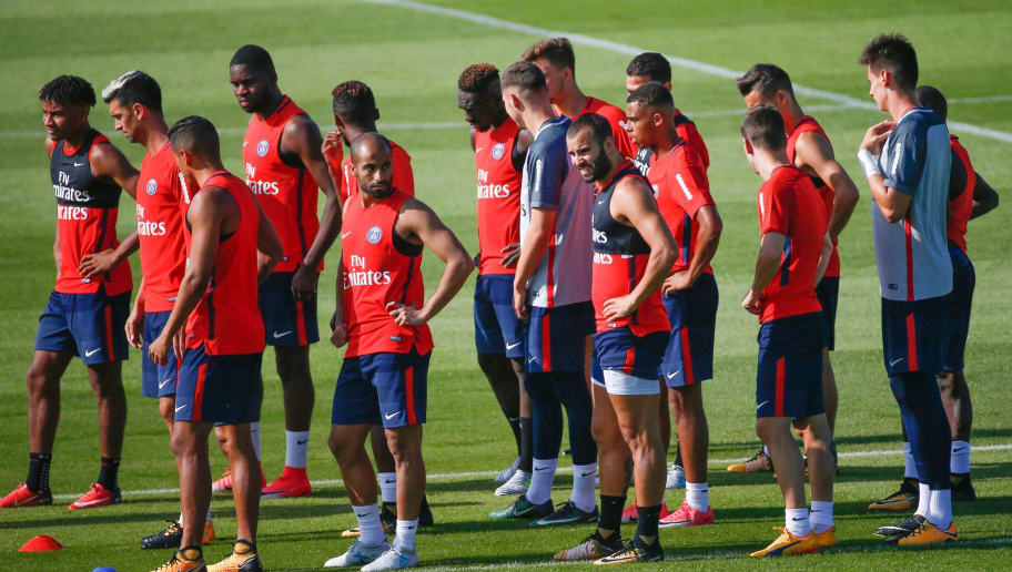 Paris Saint-Germain's (PSG) spanish forward Jese (C-R), Brazilian midfielder Lucas Moura (C-L) and teammates take part in a training session at the Oredoo training Centre in Saint-Germain-en-Laye on July 4, 2017. / AFP PHOTO / GEOFFROY VAN DER HASSELT        (Photo credit should read GEOFFROY VAN DER HASSELT/AFP/Getty Images)