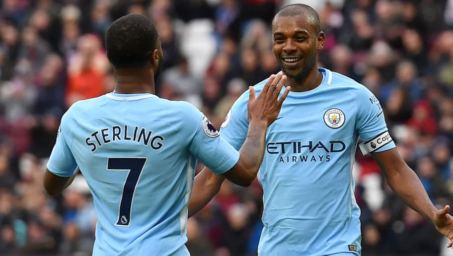 Manchester City's Brazilian midfielder Fernandinho (R) celebrates with Manchester City's English midfielder Raheem Sterling (L) after scoring their fourth goal during the English Premier League football match between West Ham United and Manchester City at The London Stadium, in east London on April 29, 2018. (Photo by Ben STANSALL / AFP) / RESTRICTED TO EDITORIAL USE. No use with unauthorized audio, video, data, fixture lists, club/league logos or 'live' services. Online in-match use limited to 75 images, no video emulation. No use in betting, games or single club/league/player publications. /         (Photo credit should read BEN STANSALL/AFP/Getty Images)