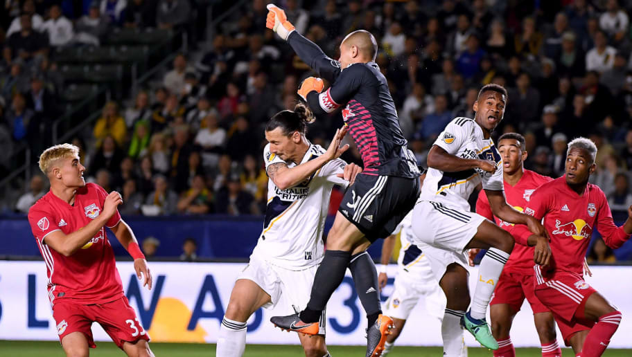 CARSON, CA - APRIL 28:  Luis Robles #31 of New York Red Bulls clears the ball on a cross as he collides with Zlatan Ibrahimovic #9 of Los Angeles Galaxy during the second half of a 3-2 Red Bulls win at StubHub Center on April 28, 2018 in Carson, California.  (Photo by Harry How/Getty Images)