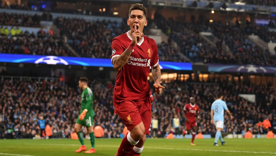 MANCHESTER, ENGLAND - APRIL 10:  Roberto Firmino of Liverpool celebrates after scoring his sides second goal during the UEFA Champions League Quarter Final Second Leg match between Manchester City and Liverpool at Etihad Stadium on April 10, 2018 in Manchester, England.  (Photo by Laurence Griffiths/Getty Images,)