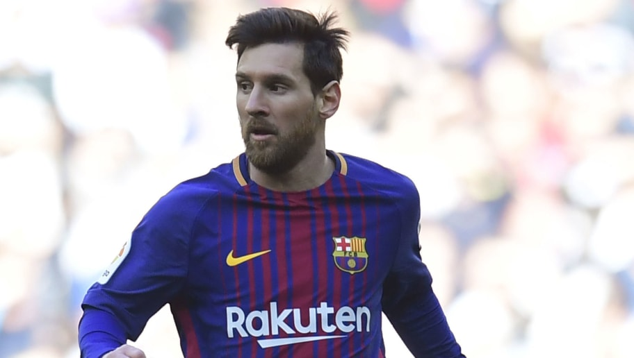 Barcelona's Argentinian forward Lionel Messi controls the ball during the Spanish League 'Clasico' football match Real Madrid CF vs FC Barcelona at the Santiago Bernabeu stadium in Madrid on December 23, 2017.  / AFP PHOTO / JAVIER SORIANO        (Photo credit should read JAVIER SORIANO/AFP/Getty Images)
