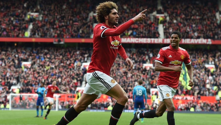 Manchester United's Belgian midfielder Marouane Fellaini celebrates after scoring their late second goal during the English Premier League football match between Manchester United and Arsenal at Old Trafford in Manchester, north west England, on April 29, 2018. (Photo by Paul ELLIS / AFP) / RESTRICTED TO EDITORIAL USE. No use with unauthorized audio, video, data, fixture lists, club/league logos or 'live' services. Online in-match use limited to 75 images, no video emulation. No use in betting, games or single club/league/player publications. /         (Photo credit should read PAUL ELLIS/AFP/Getty Images)