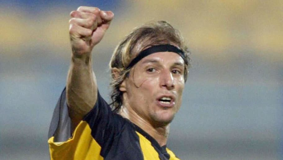 DOHA, QATAR:  (FILE) Argentinian Claudio Caniggia jubilates after scoring the second goal for his team Qatar, against al-Sailiyah club during a match in Doha 06 February 2004. Caniggia, one of the stars of Argentinian football during the last decade, announced 19 February 2005 his retirement at the age of 38. The Argentinian striker, who made his professional debut with River Plate in 1985, also played for Verona, Atalanta, AS Roma, Boca Juniors, Benfica and Dundee before moving to Rangers and finally Qatar Club. He played 50 matches and scored 16 goals for his country in an international career which spanned 15 years from 1987, and in all he played 457 matches and scored 122 goals.  AFP PHOTO/Karim JAAFAR  (Photo credit should read KARIM JAAFAR/AFP/Getty Images)