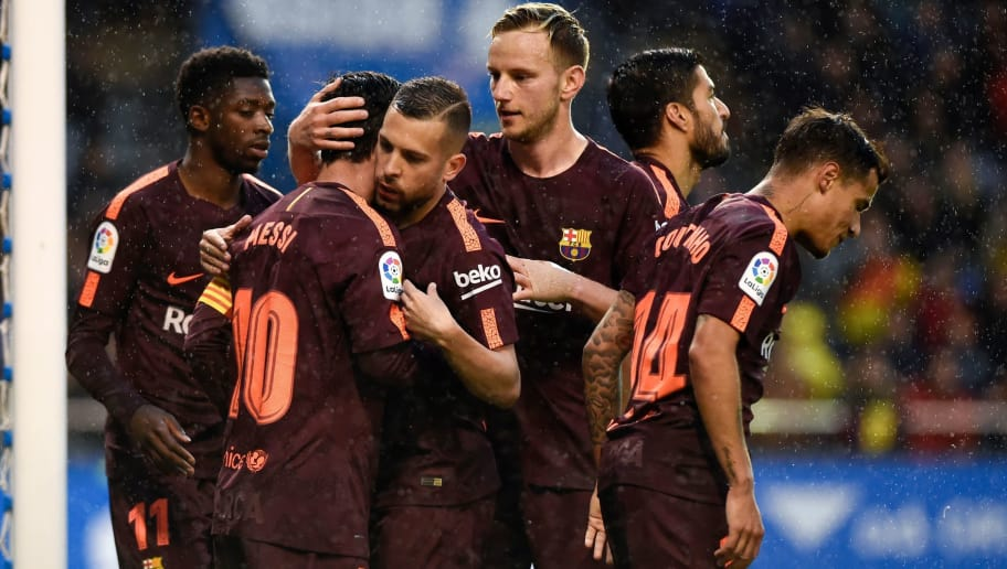 Barcelona's Argentinian forward Lionel Messi (2ndL) celebrates with teammates after scoring a goal during the Spanish league football match between Deportivo Coruna and FC Barcelona at the Riazor stadium in Coruna on April 29, 2018. (Photo by MIGUEL RIOPA / AFP)        (Photo credit should read MIGUEL RIOPA/AFP/Getty Images)
