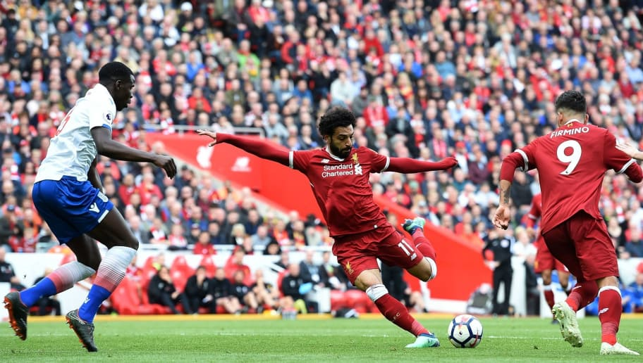 TOPSHOT - Liverpool's Egyptian midfielder Mohamed Salah (C) controls the ball during the English Premier League football match between Liverpool and Stoke City at Anfield in Liverpool, north west England on April 28, 2018. (Photo by Paul ELLIS / AFP) / RESTRICTED TO EDITORIAL USE. No use with unauthorized audio, video, data, fixture lists, club/league logos or 'live' services. Online in-match use limited to 75 images, no video emulation. No use in betting, games or single club/league/player publications. /         (Photo credit should read PAUL ELLIS/AFP/Getty Images)