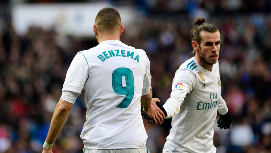 Real Madrid's French forward Karim Benzema (L) celebrates with Real Madrid's Welsh forward Gareth Bale (R) after Real Madrid's Portuguese forward Cristiano Ronaldo scored during the Spanish league football match between Real Madrid CF and Deportivo Alaves at the Santiago Bernabeu stadium in Madrid on February 24, 2018. / AFP PHOTO / PIERRE-PHILIPPE MARCOU        (Photo credit should read PIERRE-PHILIPPE MARCOU/AFP/Getty Images)