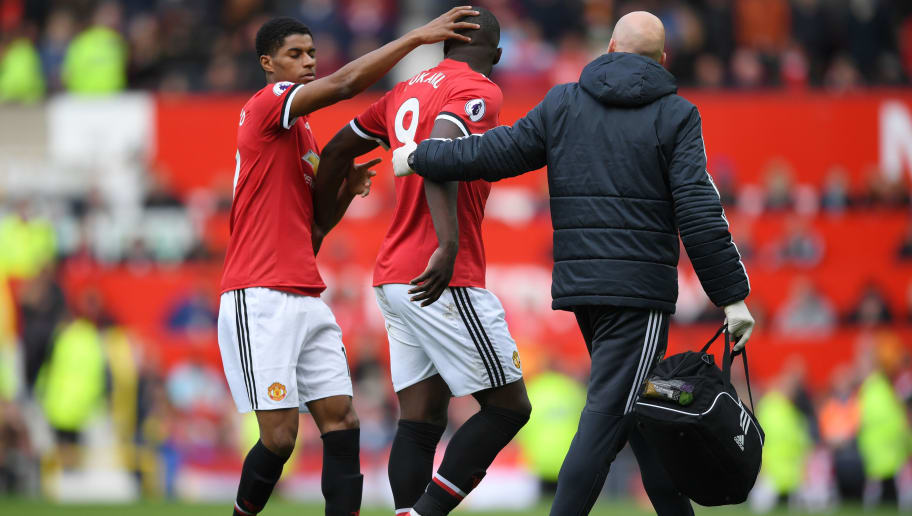 MANCHESTER, ENGLAND - APRIL 29: Marcus Rashford of Manchester United patts Romelu Lukaku of Manchester United on the head after he is taken off injured during the Premier League match between Manchester United and Arsenal at Old Trafford on April 29, 2018 in Manchester, England.  (Photo by Shaun Botterill/Getty Images)