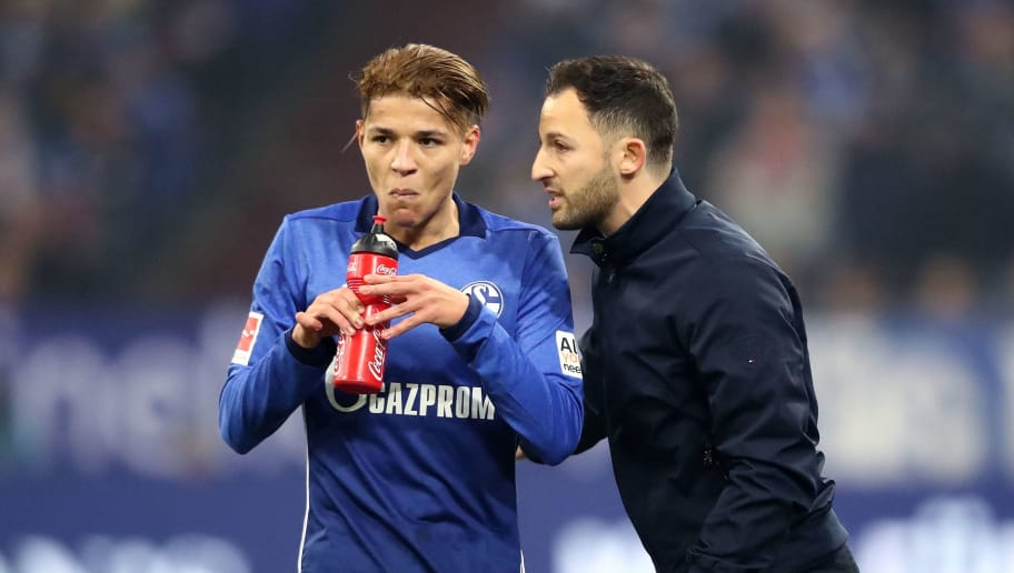 GELSENKIRCHEN, GERMANY - DECEMBER 02: Head coach Domenico Tedesco of Schalke (R) speaks to Amine Harit of Schalke (L) during the Bundesliga match between FC Schalke 04 and 1. FC Koeln at Veltins-Arena on December 2, 2017 in Gelsenkirchen, Germany.  (Photo by Christof Koepsel/Bongarts/Getty Images)