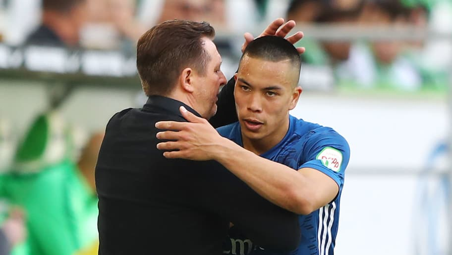WOLFSBURG, GERMANY - APRIL 28: Christian Titz, coach of Hamburg, shakes hands with Bobby Wood of Hamburg as he comes off, during the Bundesliga match between VfL Wolfsburg and Hamburger SV at Volkswagen Arena on April 28, 2018 in Wolfsburg, Germany. (Photo by Martin Rose/Bongarts/Getty Images)