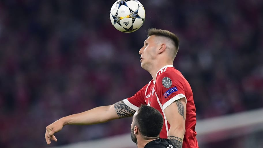 Bayern Munich's German defender Niklas Suele (up) heads the ball next to Real Madrid's Spanish defender Dani Carvajal during the UEFA Champions League semi-final first-leg football match FC Bayern Munich v Real Madrid CF in Munich, southern Germany on April 25, 2018. (Photo by JAVIER SORIANO / AFP)        (Photo credit should read JAVIER SORIANO/AFP/Getty Images)