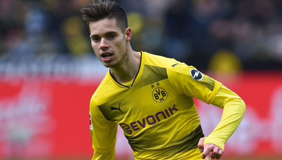 Dortmund's German midfielder Julian Weigl plays the ball during the German first division Bundesliga football match Borussia Dortmund vs Hanover 96, in Dortmund, western Germany, on March 18, 2018. / AFP PHOTO / Patrik STOLLARZ / RESTRICTIONS: DURING MATCH TIME: DFL RULES TO LIMIT THE ONLINE USAGE TO 15 PICTURES PER MATCH AND FORBID IMAGE SEQUENCES TO SIMULATE VIDEO. == RESTRICTED TO EDITORIAL USE == FOR FURTHER QUERIES PLEASE CONTACT DFL DIRECTLY AT + 49 69 650050         (Photo credit should read PATRIK STOLLARZ/AFP/Getty Images)